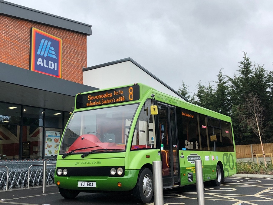 Photo of the number 8 bus parked outside a supermarket