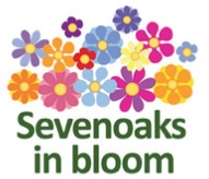 Sevenoaks in bloom logo (multicoloured flowers with green text underneath)